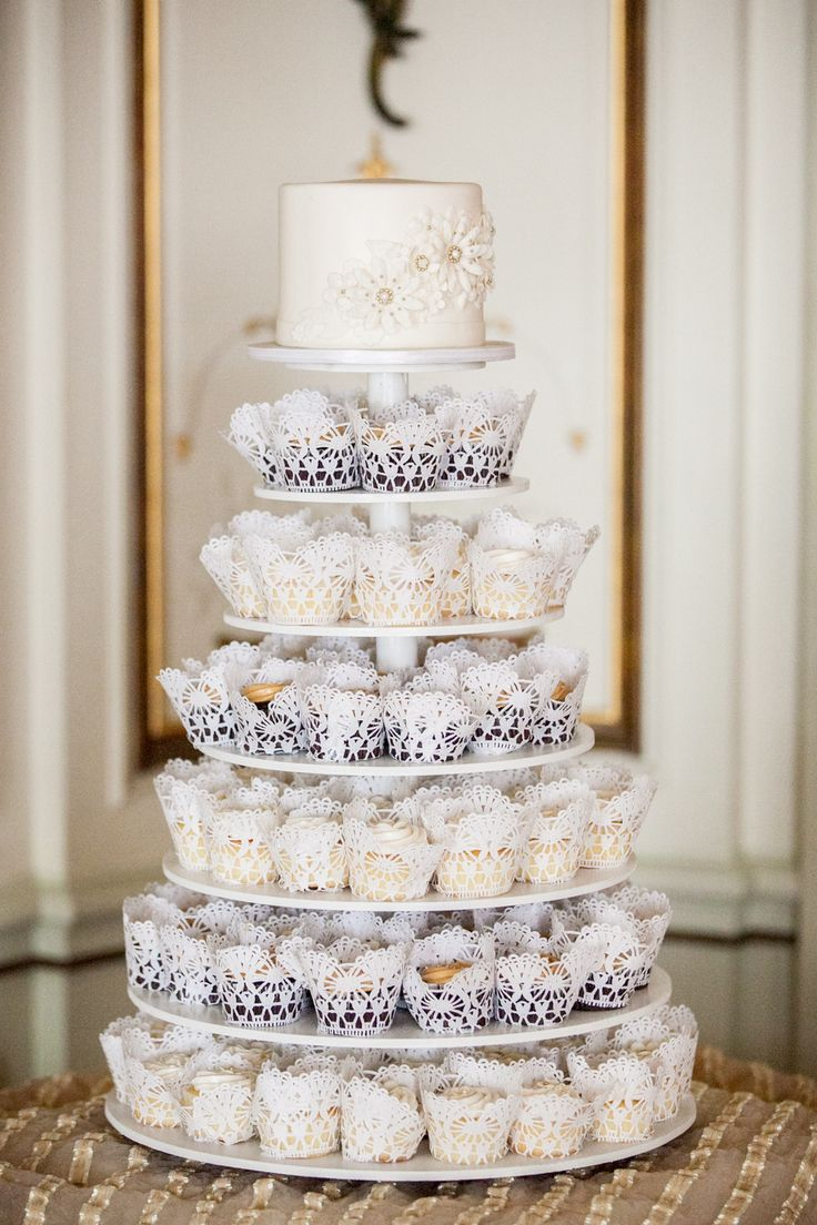 This is the idea we are going for - cake on top, cupcakes underneath - Cupcake Tower on SMP | Photography: Sara Wight Photography