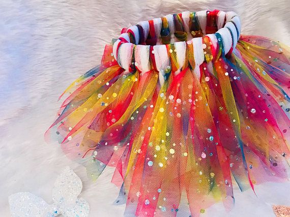 Every little girls deserves there own tutu whether is for their birthday, or just for imaginary play. This beautiful tutu is made out off rainbow with sequences for sparkle effect and white tulle material the perfect fabric for tutus. With an elasticated waist this tutu is made to