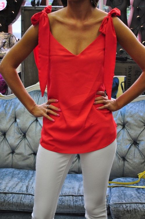 Coral Judith March top paired with Henry and Belle skinny white jeans.