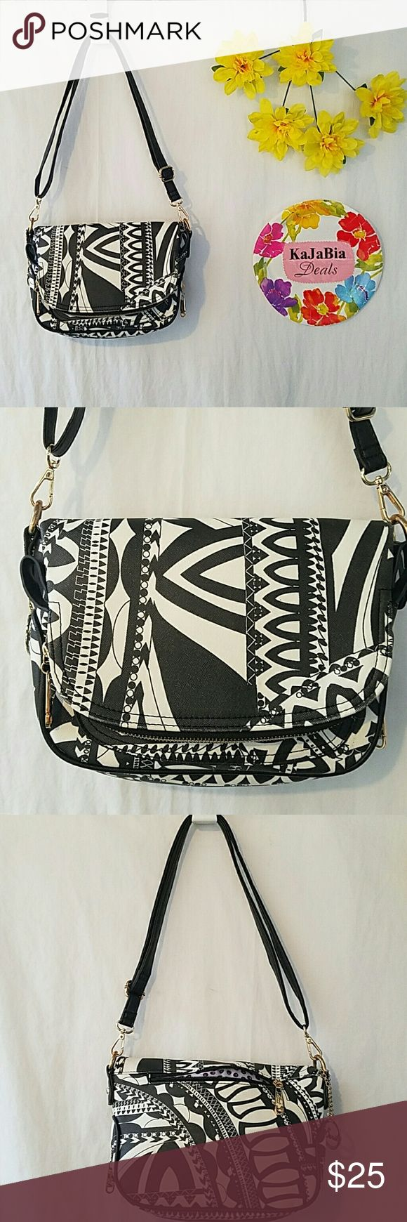 Sarit Crossbody/shoulder Bag Nice black and white print. Gold zipers. Plenty of pockets. Gently used condition. Very pretty. Bags Crossbody Bags
