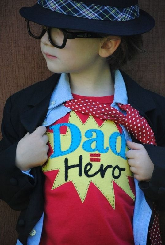 Creative kid portrait ideas for Father's Day: Dress your kids up in a t-shirt with just the right sentiment like this Dad = Hero tee from Once Upon a Story on Etsy