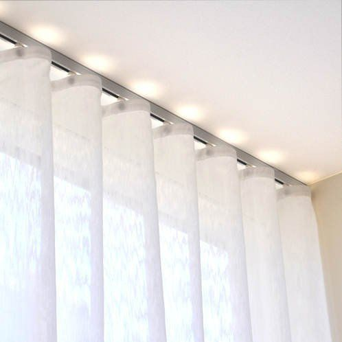 Deco track anodized aluminum ripplefold curtain track sets with a rounded front for a decorative flair. Simple baton draw sets with wheeled ripplefold carriers.