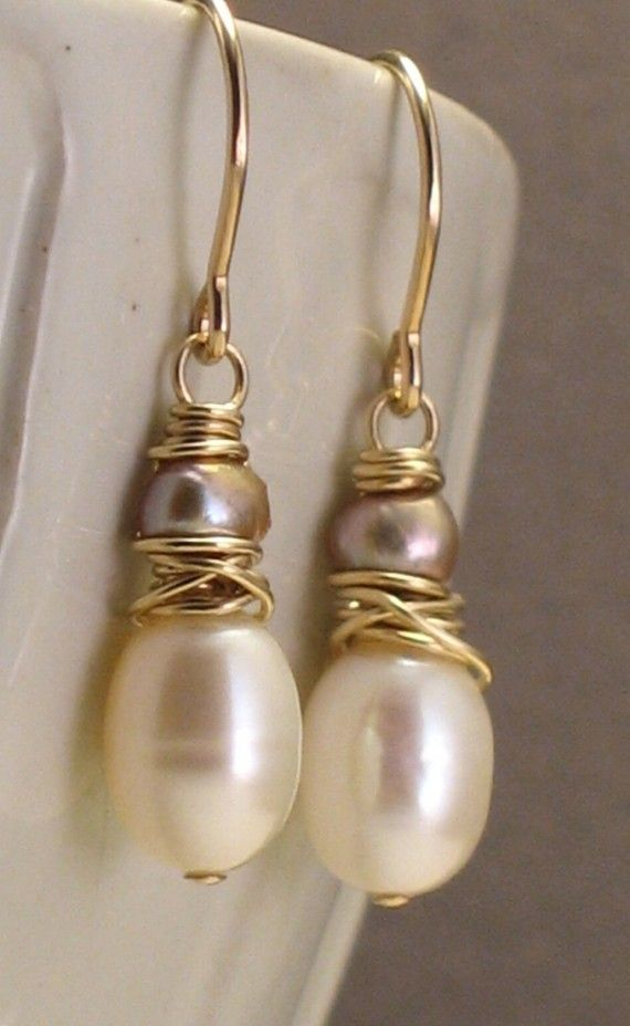 These beautiful handmade earrings combine perfect ivory pearls and tiny baroque pearls in a warm golden champagne color. Wire-wrapped by hand on 14k