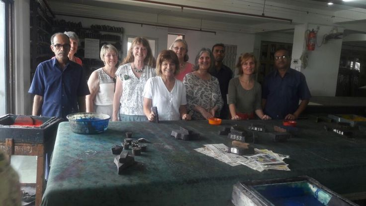 A group of 16 foreigners at the Weavers Studio factory for a small workshop in screen and block printing.