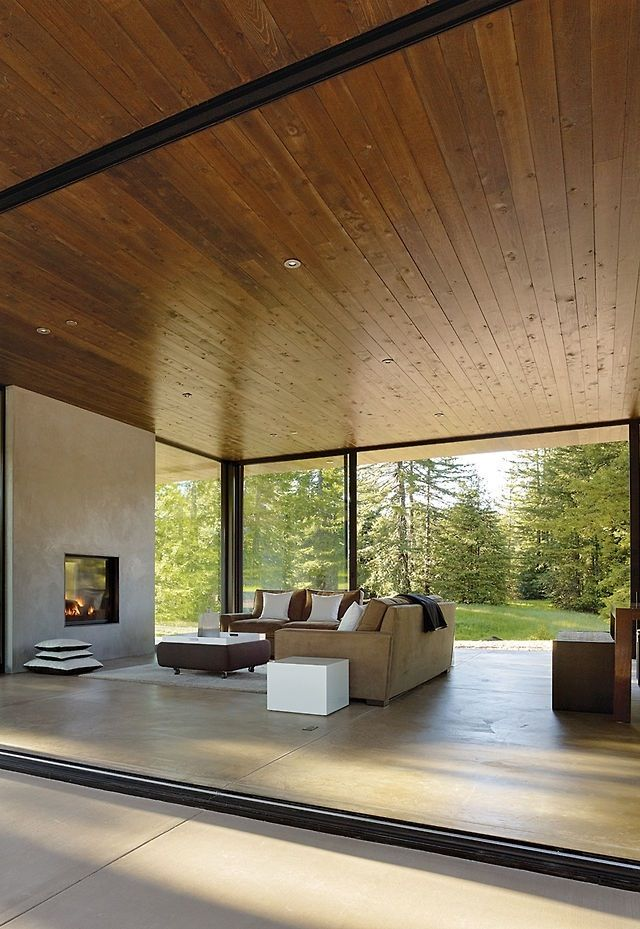 Open living room, timber ceilings.