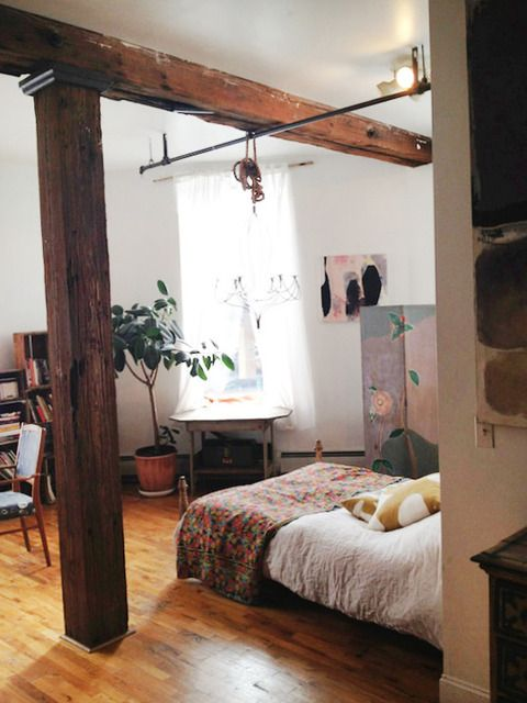 Bohemian, eclectic, well worn bedroom + exposed beams