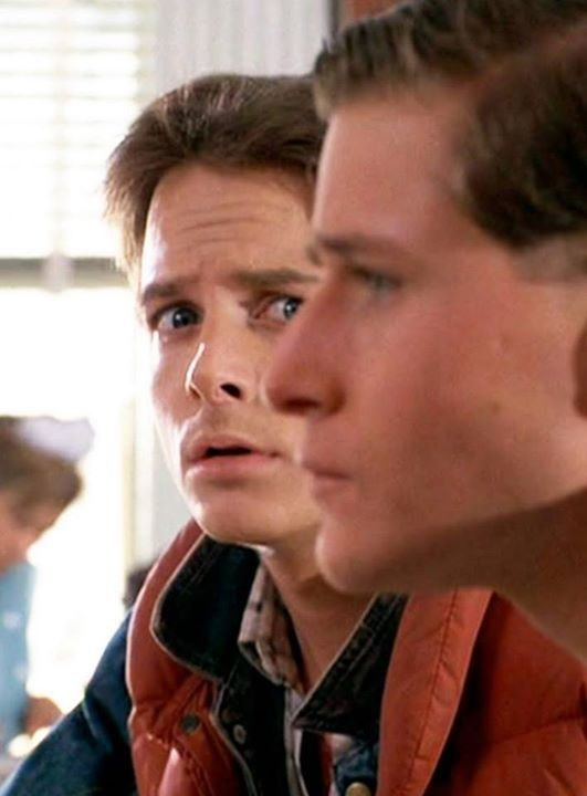 Marty (Michael J. Fox) and George McFly (Crispin Glover) in Back To The Future (1985)