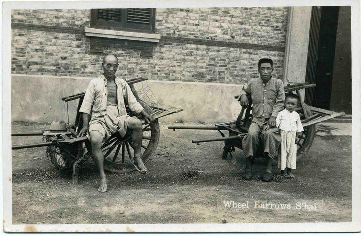 Wheelbarrows and wheelbarrow pullers [postcard]