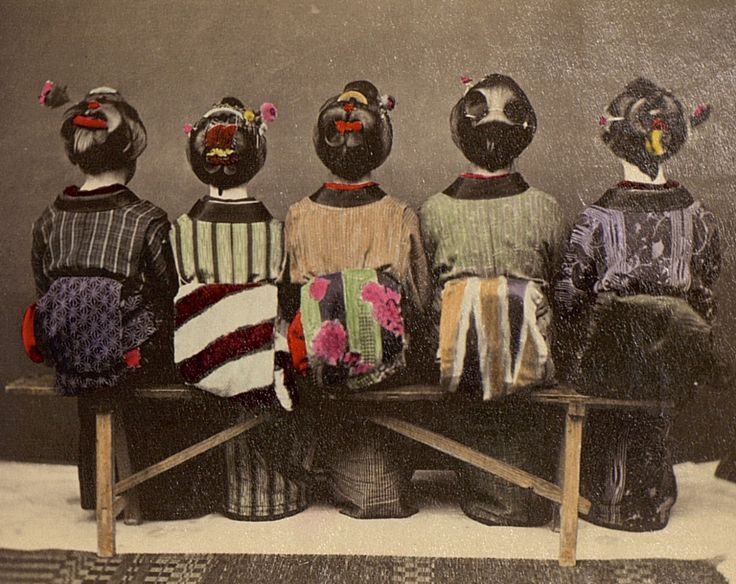 Five women on a bench. Hand-colored image, 1909, Japan.
