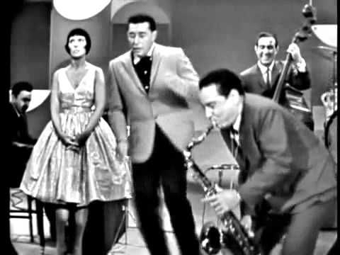 Louis Prima - Night Train with Sam Butera on Sax and Keely Smith as the perfect Foil to Louis's craziness.  Sorry I HAVE to throw in a bit of jazz here and there, I mean really they go hand in hand anyhow, and bleed into each other. LOL  And Night Train is one of my favorites and THIS one IS the ONLY Night Train! LOL