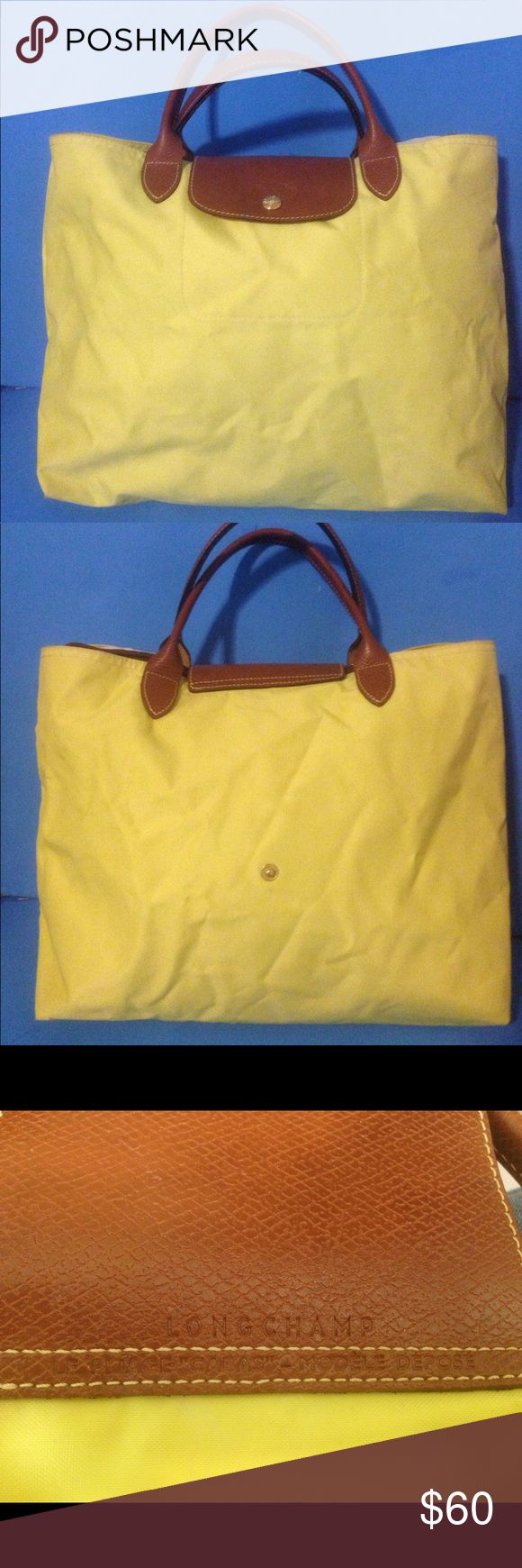 "LONGCHAMP Le Pliage ""Lemon"" Nylon medium Tote bag In good used condition few marks inside. Other then that still a great a bag. ""Note""  this has no zipper it's a snap on. Questions please ask. Thank you. Longchamp Bags Totes"