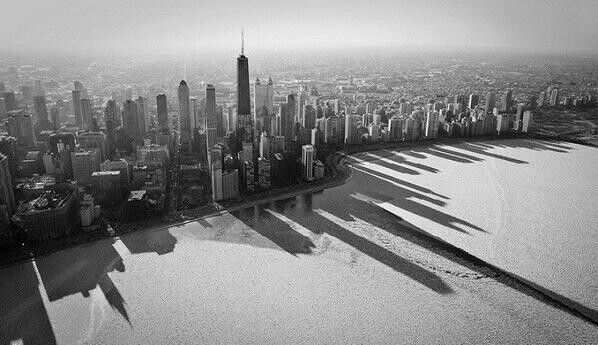 Beautiful and surreal. Chicago resting by the frozen lake.