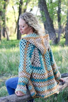 """Believe it or not, two simple granny hexagons are the foundation of this free crochet hexagon sweater pattern. """"The Campfire Cardigan"""" is made with Lion Brand New Basic 175 in Juniper, Cafe Au Lait, Thyme and Camel. Easily make this modern boho crochet sweater pattern!"""