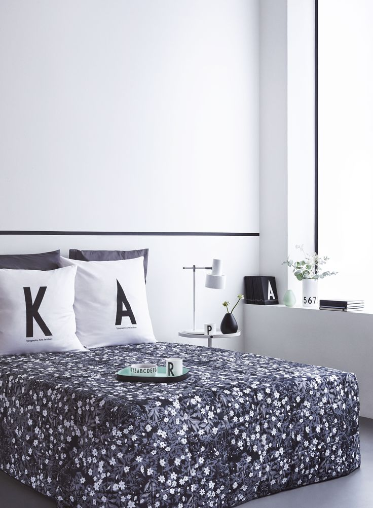 Add personal elements in the bedroom. For example a personal pillow case and notebook. Combine the AJ Vintage ABC typography with a Flowers by AJ bed cover for a cool black and white look.