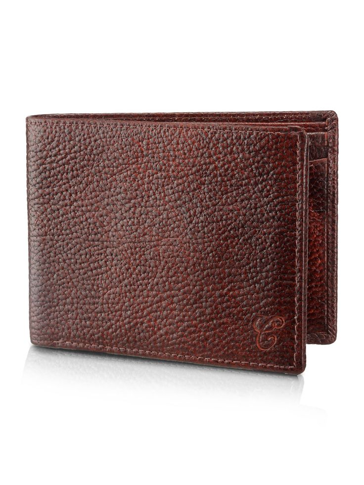 Textured Brown Genuine Leather Wallet For Men -5Card Slot -2 Note Sections -1plastic photo and card holder and a coin pocket -Two cash slots This textured leather bi-fold wallet combines all the qualities of traditional craftsmanship with contemporary design. You'll find ample space for notes and cards. A modern take on a classic favourite!