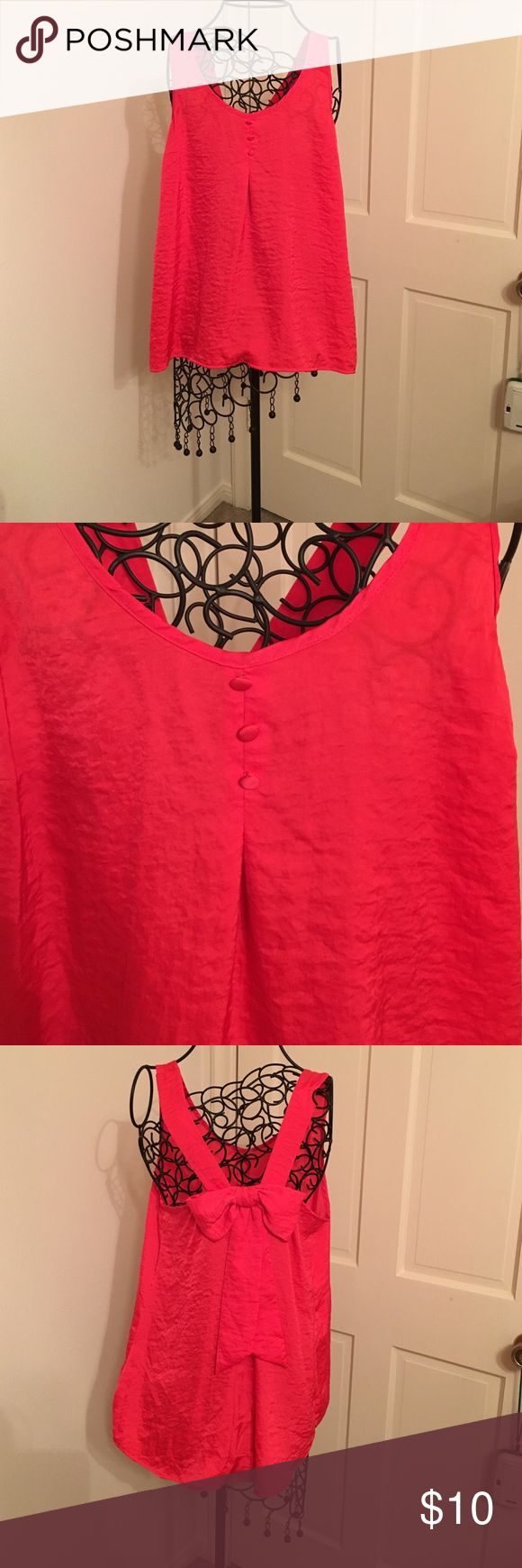 Bow back blouse Silk bow back shirt color is a pink redish... Hard to describe. Very cute Candie's Tops Blouses