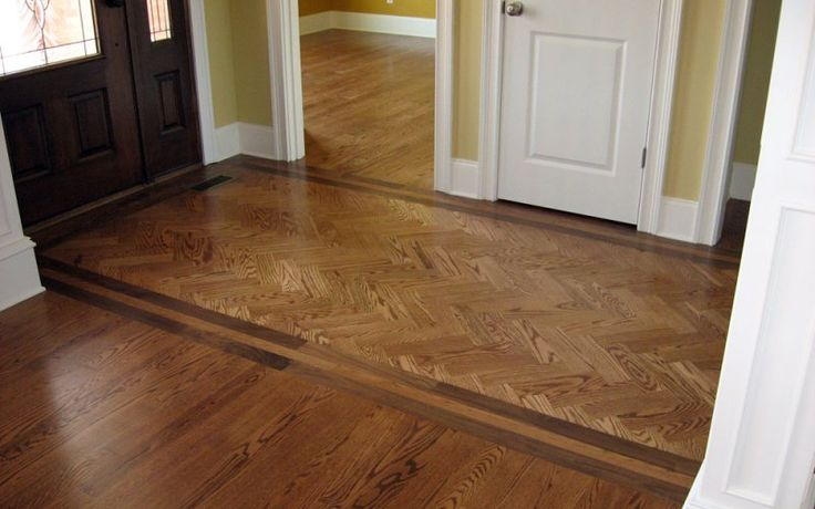 This Foyer Welcomes You With A Red Oak And Walnut