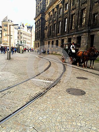 Dam Square or Dam Dutch pronunciation: [dɑm] is a town square in Amsterdam, the capital of the Netherlands. Its notable buildings and frequent events make it one of the most well-known and important locations in the city and the country.