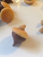Edible Acorns for Enchanted Forest Snow White Birthday Party: Mini Vanilla Wafers, Hershey Kiss, Peanut butter, peanut butter chips