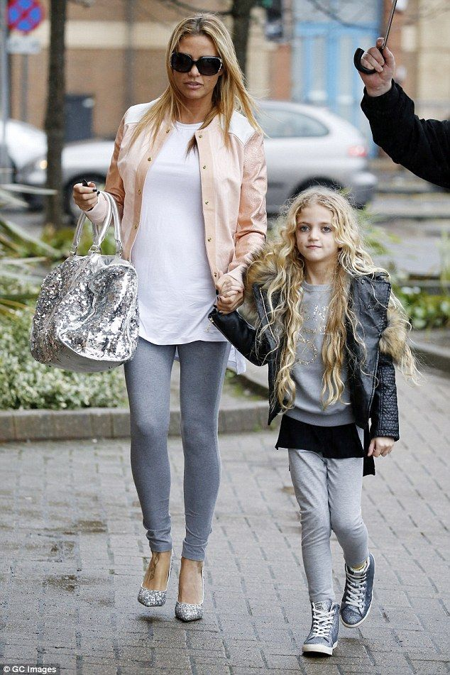 No letting go: Katie Price coordinated her leather jacket with her daughter Princess on Monday in Woking