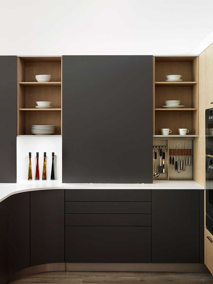 Snug Kitchens Newbury Pronorm Pro-Line range showing sliding doors in Matt Stratus Grey with Grey Oak Veneer and Glacier White Corian worktop.