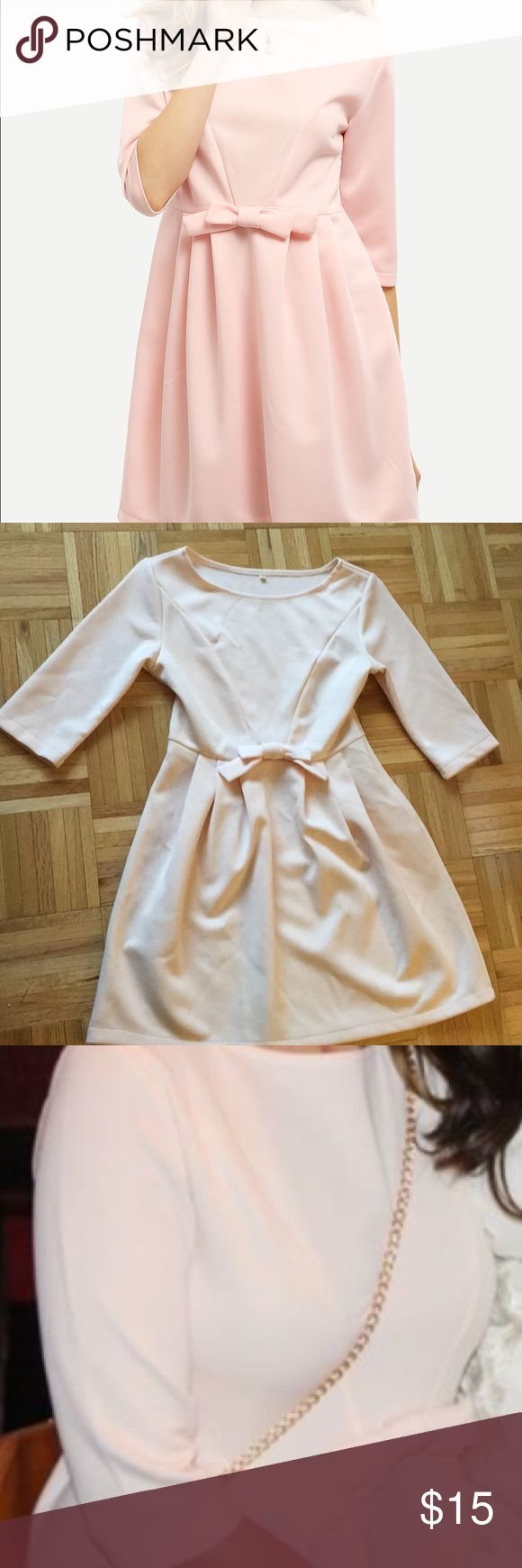 Pretty In Pink Half Sleeve Dress This cute round neck polyester dress is perfect for any occasion. The perfect bow in the front gives it a delicate feminine touch. Dresses Long Sleeve