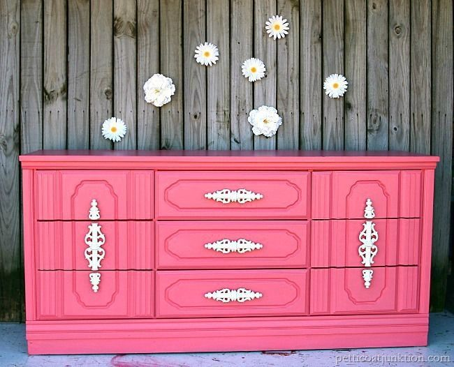 Coral Painted Nursery Dresser Furniture Makeover. Did I wow you! The coral is such a beautiful color and perfect for a nursery. The makeover was a breeze.