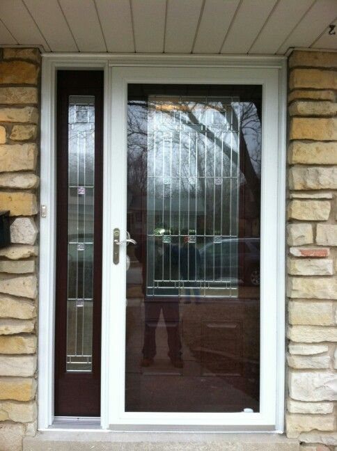 Entry with sidelite and Anderson storm door