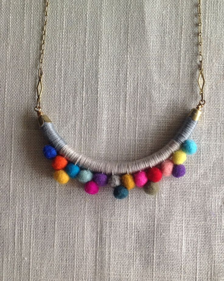 The FRANKIE Necklace Color Study No. 31--Handmade with Felted Wool Pom Poms, Cotton, Leather, and Brass. Etsy.