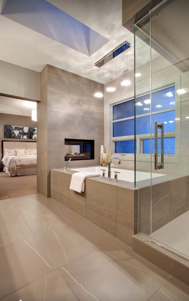 getting fancy - dream bathroom.  and maybe above the fireplace there's a TV that swivels between the bedroom and bathroom??  genius.