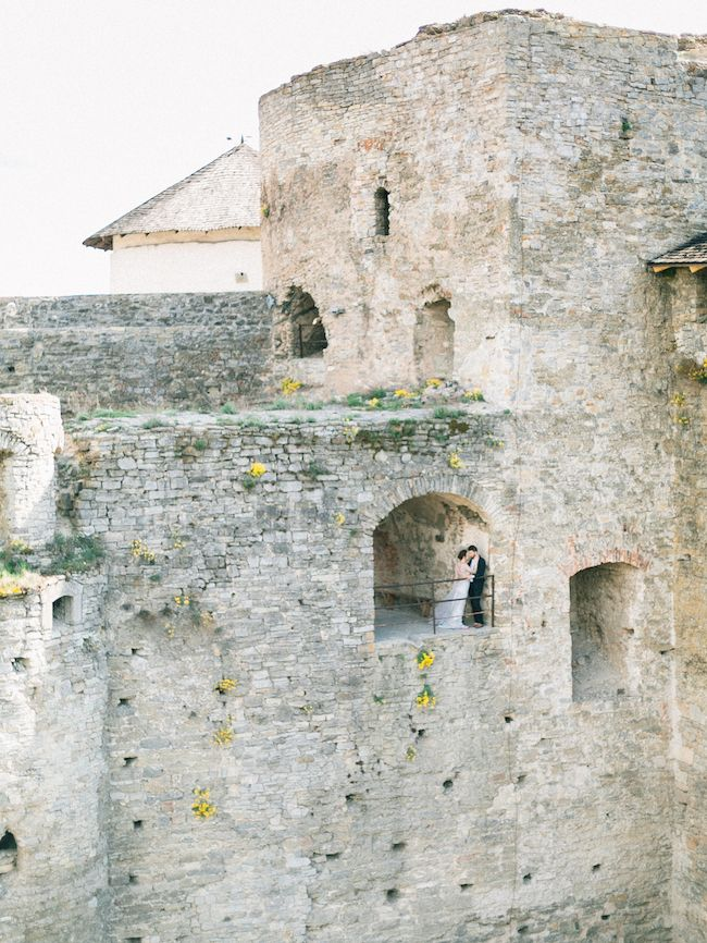 Fine art elegance at Kamianets-Podilskyi Castle, Ukraine. Photo by Slava Mishura | Stationery by Aleska | Featured on Truly and Madly Wedding Blog