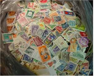 This bag of stamps just hints at why it can be so difficult and overwhelming to determine stamp values.  Many stamp collections have boxes and boxes of random accumulated stamps like these.  The vast majority aren't worth anything but...you never know what's in a bag like this!