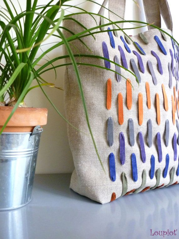 Shopping bag decorated raw linen leather bands of several