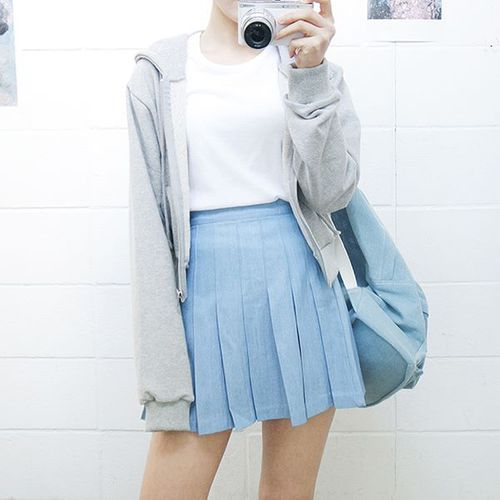 White t-shirt with a light blue skirt ad a gray jacket                                                                                                                                                      More