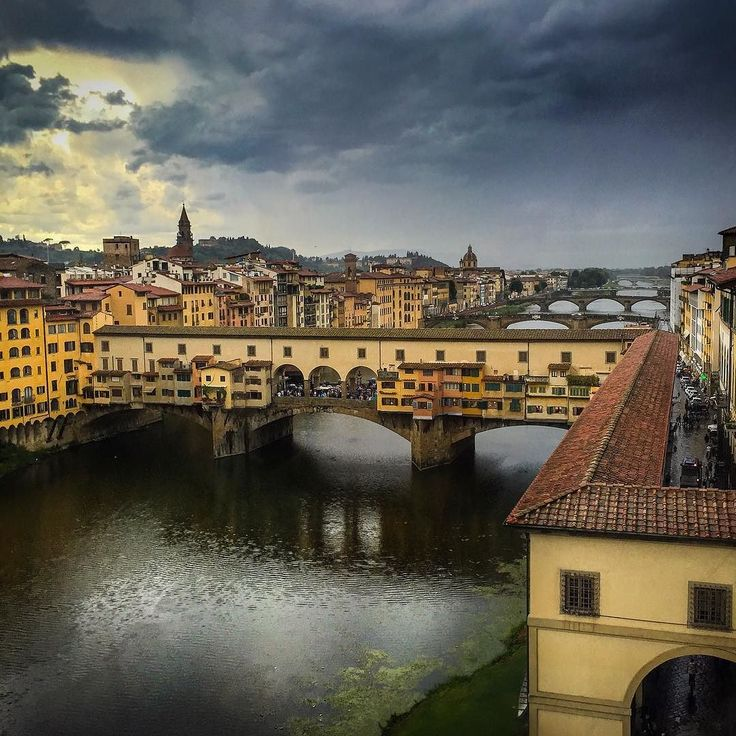 The Ponte Vecchio Florence on a stormy day.  #florence #italy #landscapes #pontevecchio #tuscany #river #architecturephotography #storm #clouds #stormclouds