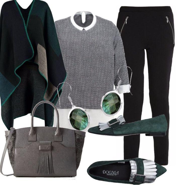 Outfit di tendenza pensato per una grintosa curvy. Pantalone nero skinny, blusa grigia effetto camicia bianca. Mantella nei colori del nero, grigio, verde. Borsa in pelle grigia. Mocassino verde con particolare di frange argento. Orecchini verdi.