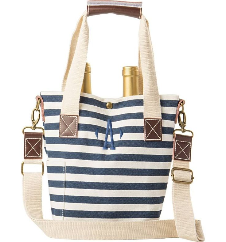 A single initial monogram adds a personal touch to this waxed canvas tote that's picnic-ready with space for two wine bottles and an interior divider to prevent jostling. | #nautical #fashion #tote