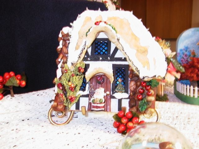 Cottages by Barb.  Lights up with battery-operated lights.  Made with Sculpy.