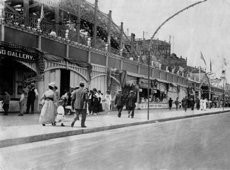 July 10, 1915: As folks strolled in their weekend finery, booths boarded up for the winter were now open with games of chance and advertised summer staples like glasses of buttermilk, Coca-Cola, ice cream, and Trask's Restaurant. The restaurant stood next to Derby Racer, one of 15 roller coasters in the park and the one owned by Howard Trask, the restaurateur.