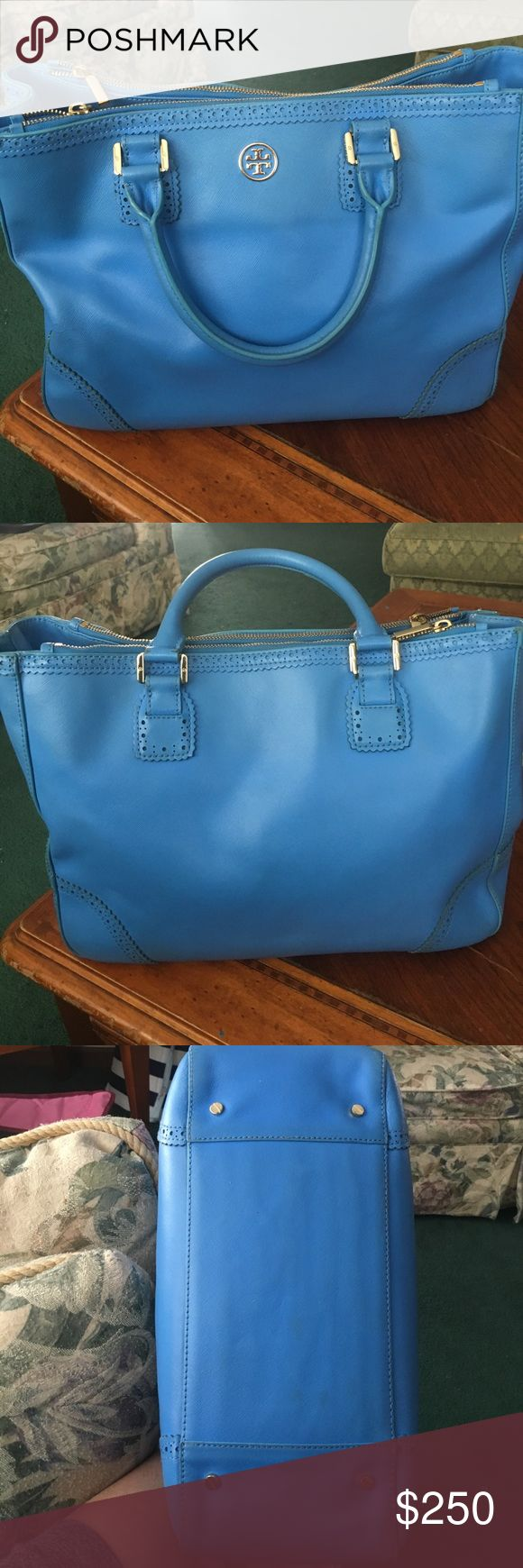 Limited Edition Tory Burch Robinson Pre loved Tory burch Robinson sky blue large tote. Has the expected wear and tear as shown in the pictures , has gorgeous lace edges, it's a Neiman Marcus limited edition bag. No low ball offers or trade offers !!  Trade value is $$$650$$$$ Tory Burch Bags Totes
