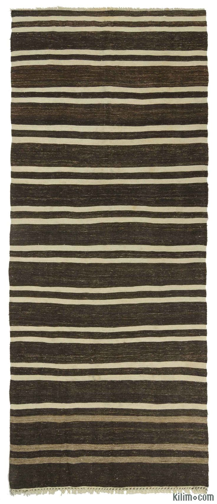 Vintage striped kilim runner rug handwoven in Turkey in 1960's. This tribal minimalist rug is in very good condition. It is perfect for contemporary settings.