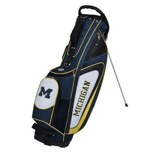 NCAA Michigan Wolverines Gridiron II Stand Bag by Team Effort. $149.95. 840D nailhead nylon construction provides protection from wear, tear, and the elements. Oversized towel ring with accessory strap. 5-way top with integrated molded handle and two full length dividers. Removable zippered rain hood included. Two-point umbrella holding system. Vibrant collegiate colors and four embroidered collegiate trademarks enable you to prominently display your support for you...