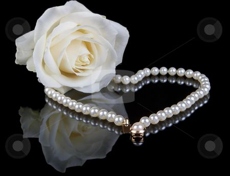 Photo of White pearls and rose