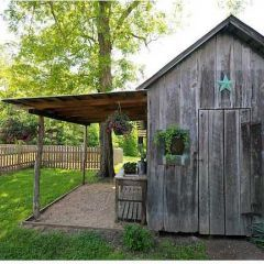 rustic shed with covered porch- would love to have one of these!!