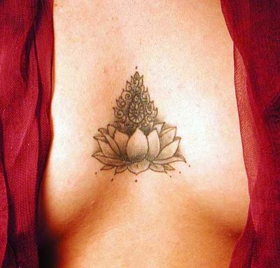 lotus tattoo. Love the placement