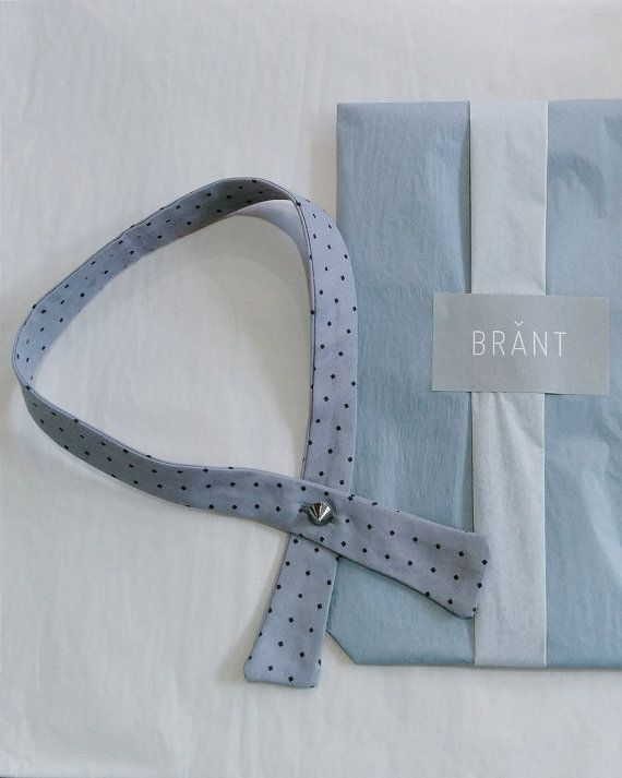 Our unique women's gray / grey bow tie is a necktie necklace and necktie scarf which will upgrade your casual, work and business clothes. This adult bow tie is a fabulous combination between a necktie and a bow tie. The pattern is of classy gray with black dots.