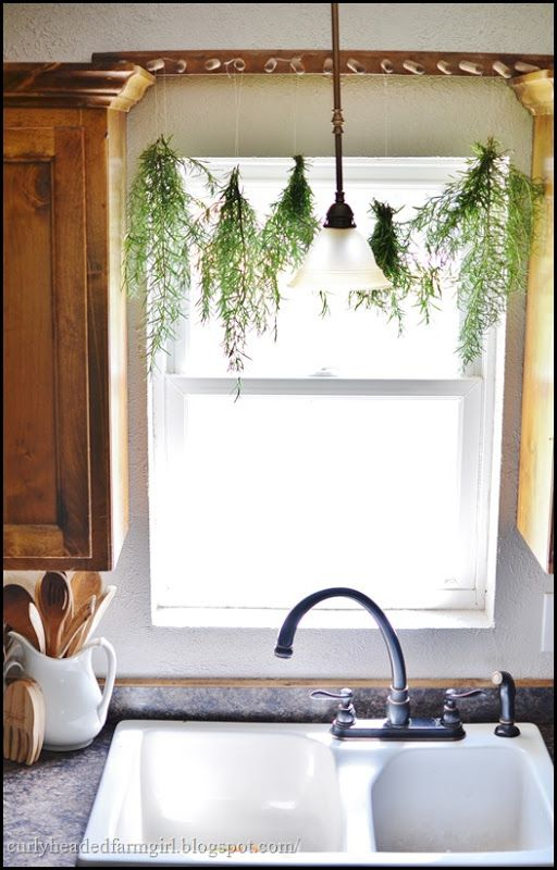 Beautiful light coming in through the window, and the rosemary hanging to dry...