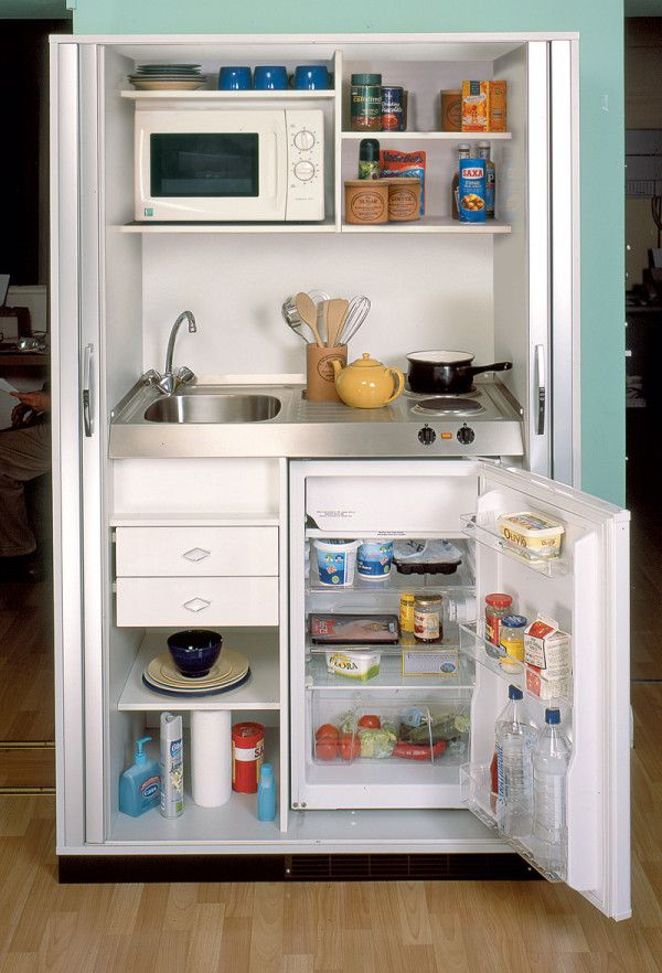 Great little kitchenette built from an old entertainment center.  Perfect for a tiny house!