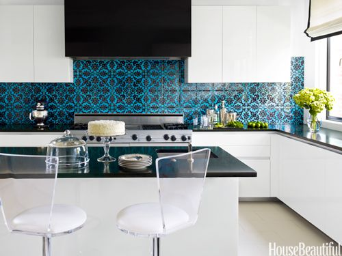 Modern white kitchen with mediterranean teal black tile for Blue countertops kitchen ideas
