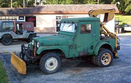 Here's something you don't see every day: A CJ-5 with a bunch of implements on it. More interesting is the fact that these were offered directly from Jeep.